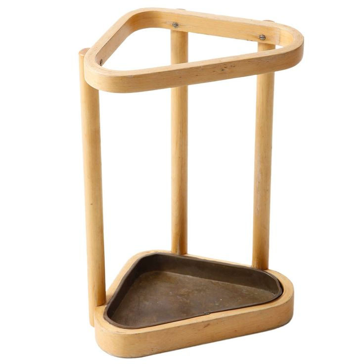 Alvar Aalto; Wood and Brass Umbrella Stand, 1936.