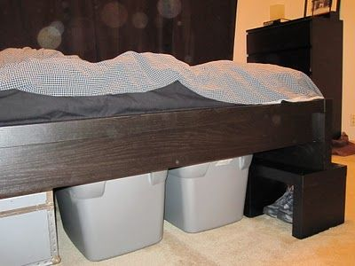 ikea malm bed set atop 2 lack bookshelves to raise the bed and create underbed storage