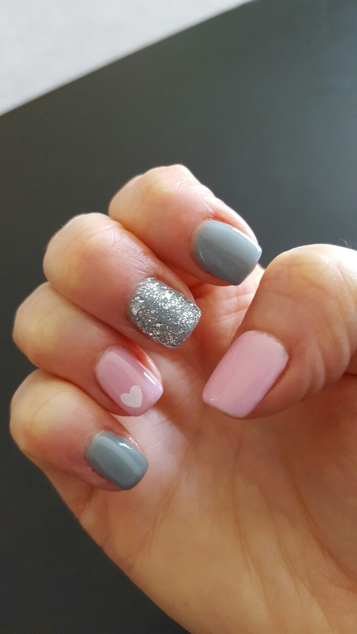 Light pink, grey, and sparkle gel nails, perfect for Valentine's Day!