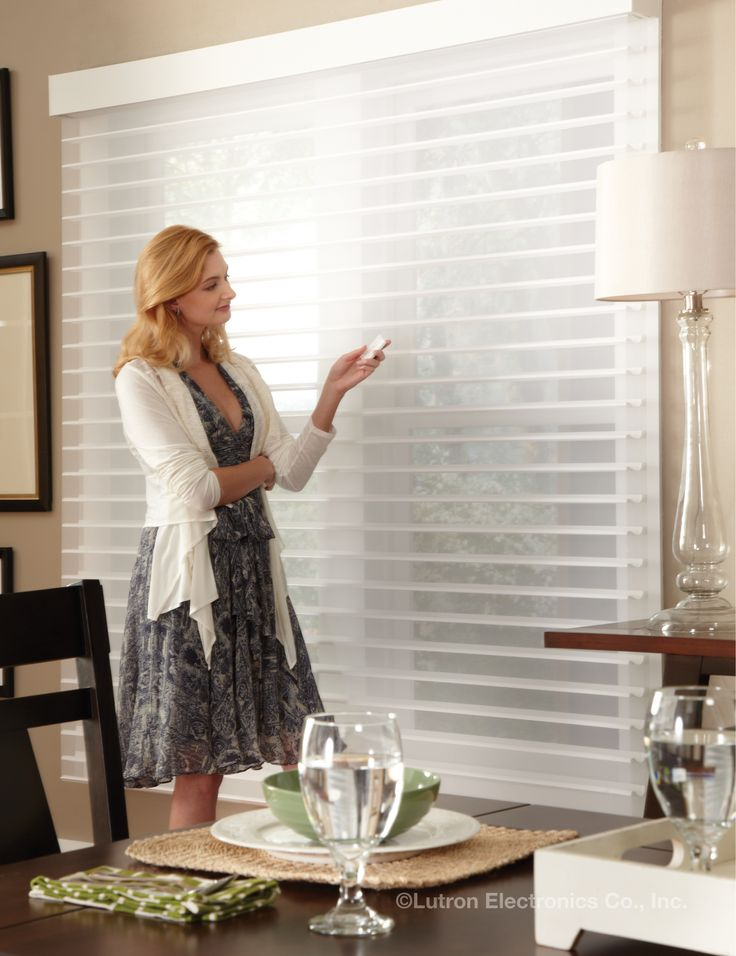 Horizontal sheer blinds, a hybrid of a sheer shade and Venetian blind, can conveniently be controlled via a remote control so height and slats all align.  www.lutron.com/fabrics