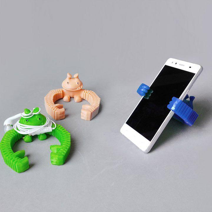 Soporte 3D para móviles y auriculares de @Shira
