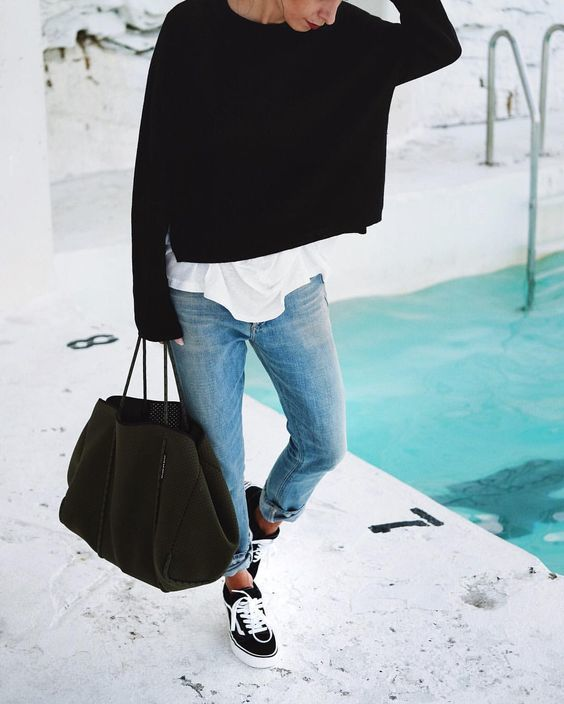 Try teaming a black oversized sweater with baby blue boyfriend jeans for an unexpectedly cool ensemble. For the maximum chicness make black and white canvas low top sneakers your footwear choice.   Shop this look on Lookastic: https://lookastic.com/women/looks/oversized-sweater-crew-neck-t-shirt-boyfriend-jeans/21721   — Black Oversized Sweater  — White Crew-neck T-shirt  — Light Blue Boyfriend Jeans  — Black Wool Tote Bag  — Black and White Canvas Low Top Sneakers