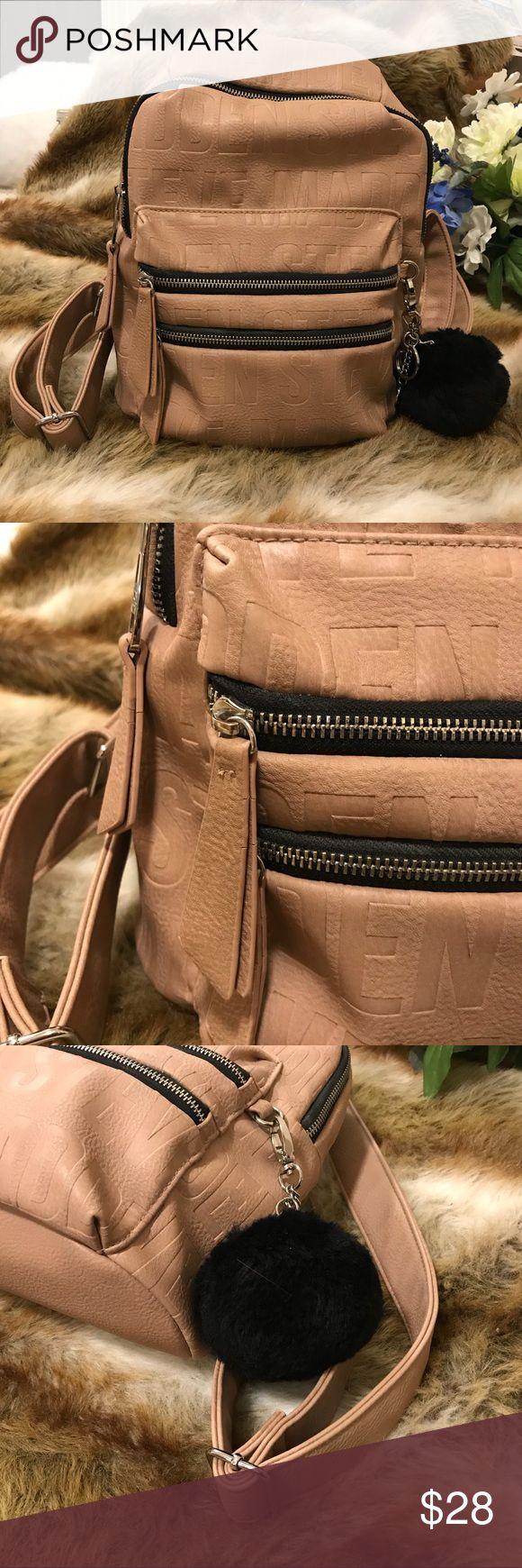 Steve Madden Mini Backpack Embossed Vegan Leather Stylish mini backpack in a nude vegan leather with Steve Madden embossed throughout the vegan leather. Also includes soft puffball keychain 😊 Steve Madden Bags Backpacks