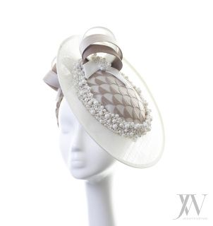 Hat:  Chloe is one of our most popular style hats. It's a sinamay disc trimmed with swirls, pearls and feathers. It's that perfect 'in between' size - not too small and not too big!  Bespoke option: This hat can be reproduced in different colours & sizes or using different materials. As every individual headpiece is handmade by Jennifer, please expect slight variations to the picture.  Sales Enquiries: For bespoke hats or wholesale enquires, please contact our customer service team: Tel:...