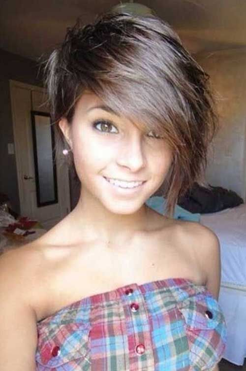 Asymmetrical Long Bang Pixie Cut. I love this! Wish i could pull it off. Maybe i can talk Kina into it.