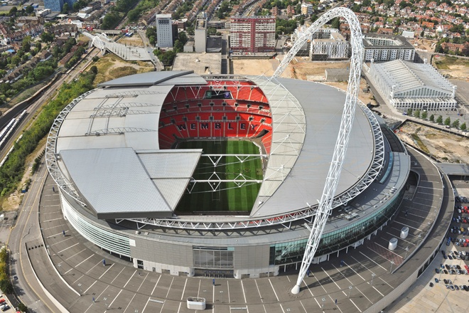 An aerial photograph of Wembley Stadium, London with the roof open
