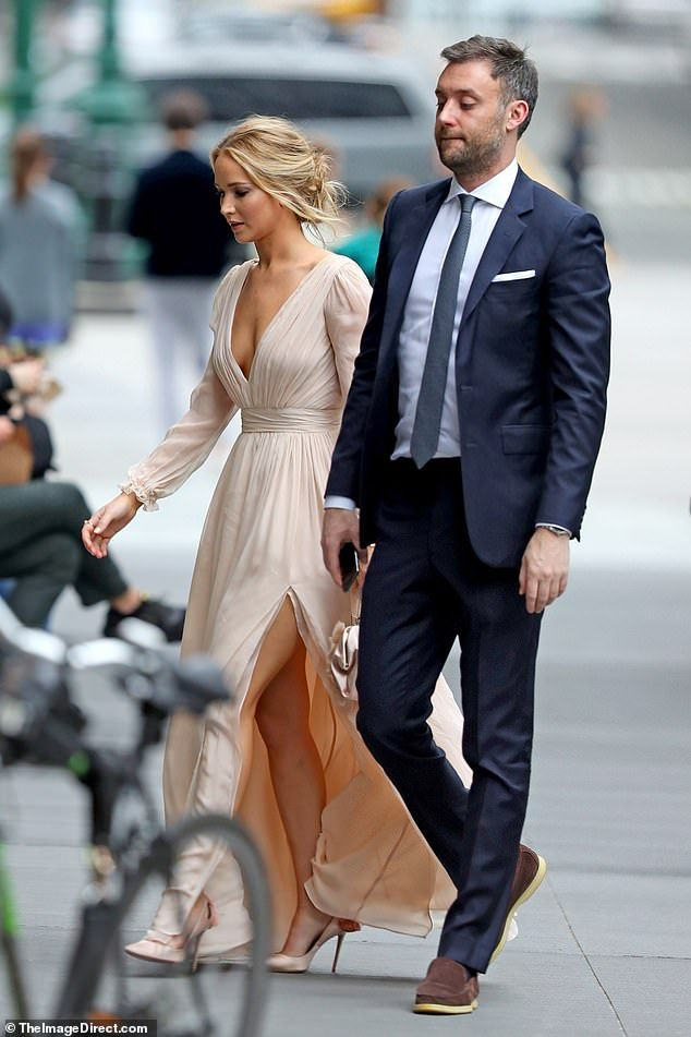 Jennifer Lawrence stuns in a peach gown as she steps out in New York