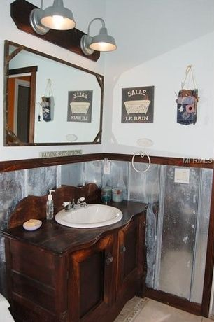 Eclectic Powder Room with Flush, Wood counters, Metal wainscoting, Tin wall tiles, limestone tile floors, Powder room