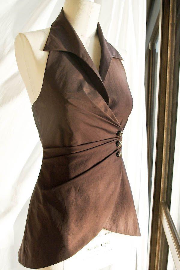 brown sleevless blouse