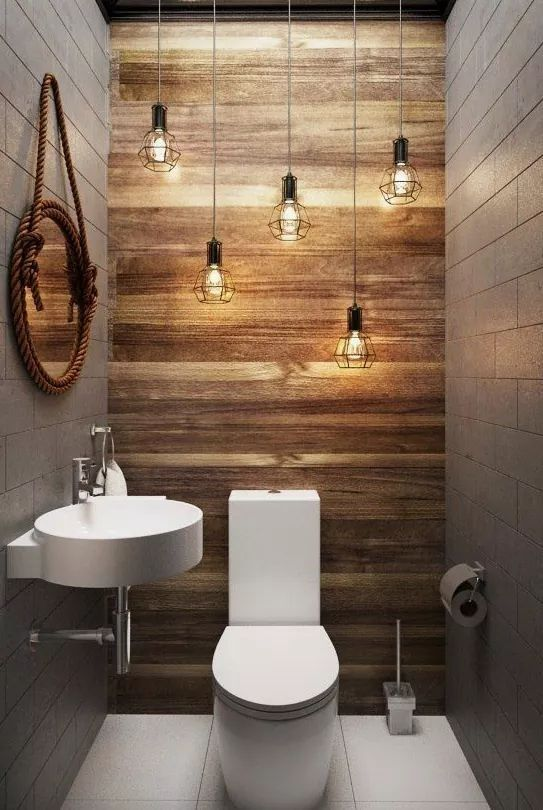 Love the lighting a wood wall with the gray for a small guest bathroom with just a toilet and sink