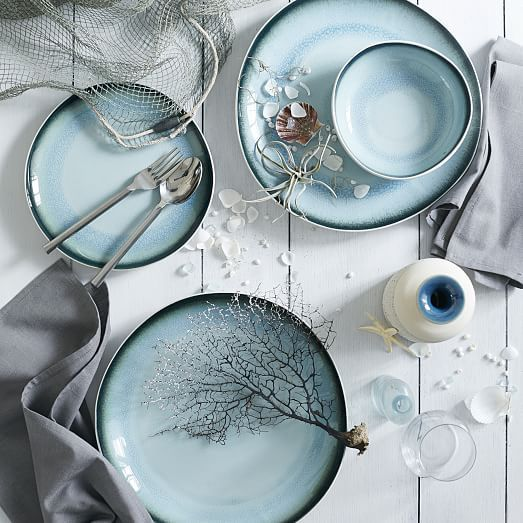 Color pop. Made of white ceramic, our Organic Shaped Crackle Dinnerware's colorful interior is achieved by heating a layer of glass until it cracks. Each piece is subtly one of a kind.
