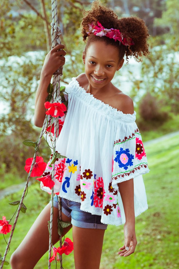 Ruby Yaya | Kids Wear. Fashion for the boho & stylish kids. Colourful, fun & comfortable dresses and Blouses.  Girl wearing ruby yaya blouse on swing. Beatiful Flower girl.