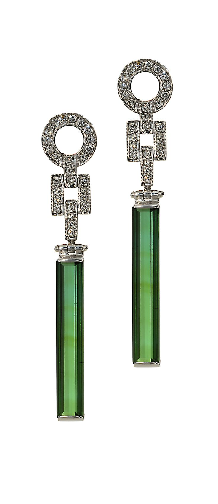 "Green is such a hot color right now and these tourmaline earrings by Graziela are the perfect accessory to spice up an evening ensemble. Set in 14K White Gold with .54cts of White Diamonds, these ""Forever Tourmaline"" earrings are sexy yet sophisticated!"