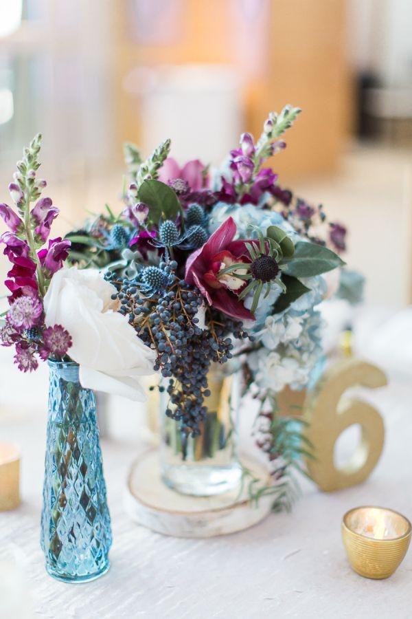Berry and magenta wedding flowers: http://www.stylemepretty.com/florida-weddings/2017/03/17/berry-blue-winter-wedding/ Photography: Emily Katharine - http://www.emilykatharine.com/