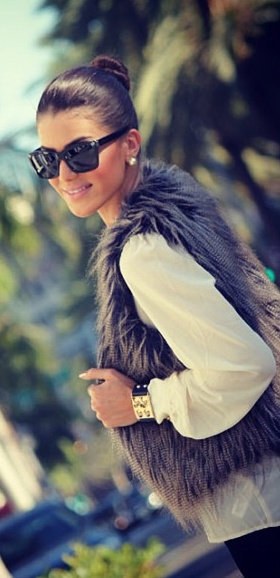 Faux fur vest with sheer, long sleeve shirt. The top-knot bun, gold earrings, and gold bangle complete the look. Cute fall style.