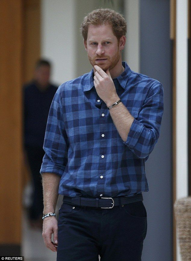 Prince Harry wore jeans and a blue checked shirt to visit the Hurlingham Club in Fulham ...
