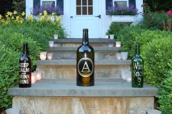 Single letter monogram in castellar font on the 3 liter bordeaux shaped bottle. Simple and elegant for a patio!