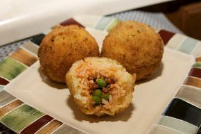 Italian rice balls with meat..   I have been hearing a ton about rice balls as of late I hope that they are as good as they look!