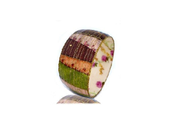 Wide bangle with colorful mutlicolor stripes print coated resin. $69.00, via Etsy.