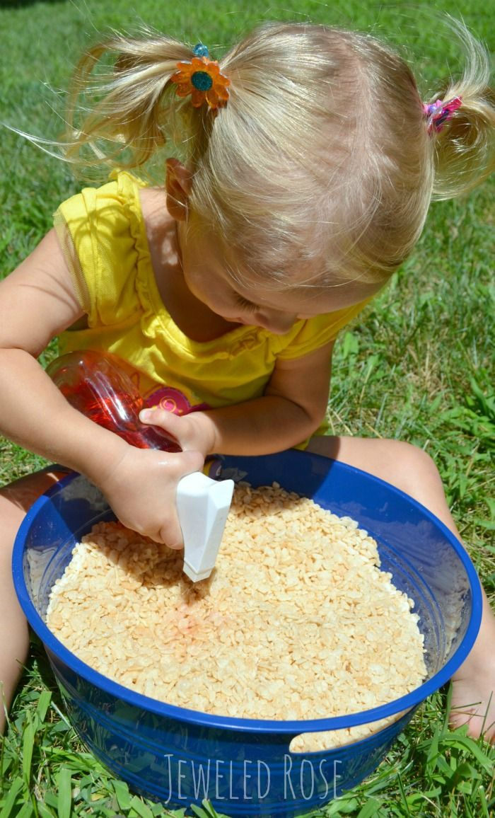 Popping rice sensory fun for kids.  This rice is GREAT FUN dry.  Add water for sensory play with sound effects or give kids spray bottles of colored water and let them paint a popping canvas- TOO FUN!