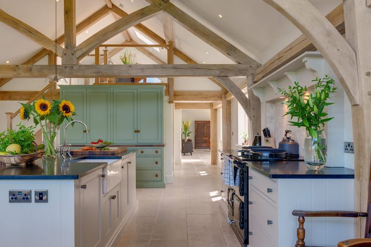 Stunning oak framed kitchen extension from Welsh Oak Frame with exposed oak trusses giving this kitchen the wow factor! #oakframe #exposedbeams #kitchenextension #kitchenideas