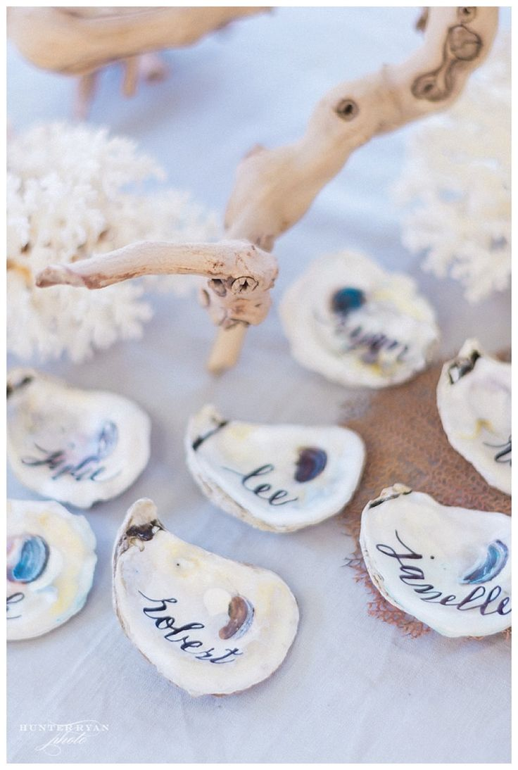 Sea glass inspired wedding | Coastal chic Florida destination wedding | South Seas Resort Planning and Design by Elleson Events   | Hunter Ryan Photo | Coral wedding decor | Floral Artistry of Sanibel | Sanibel Island wedding | LH Calligraphy | Oyster shell place cards