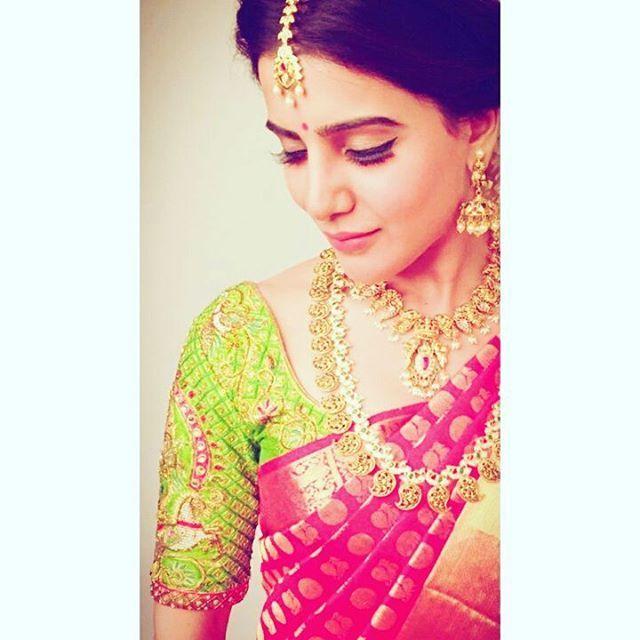 South Indian bride. Gold Indian bridal jewelry.Temple jewelry. Jhumkis. Red silk kanchipuram sari with contrast green blouse.braid with fresh jasmine flowers. Tamil bride. Telugu bride. Kannada bride. Hindu bride. Malayalee bride.Kerala bride.South Indian wedding. Samantha Prabhu.