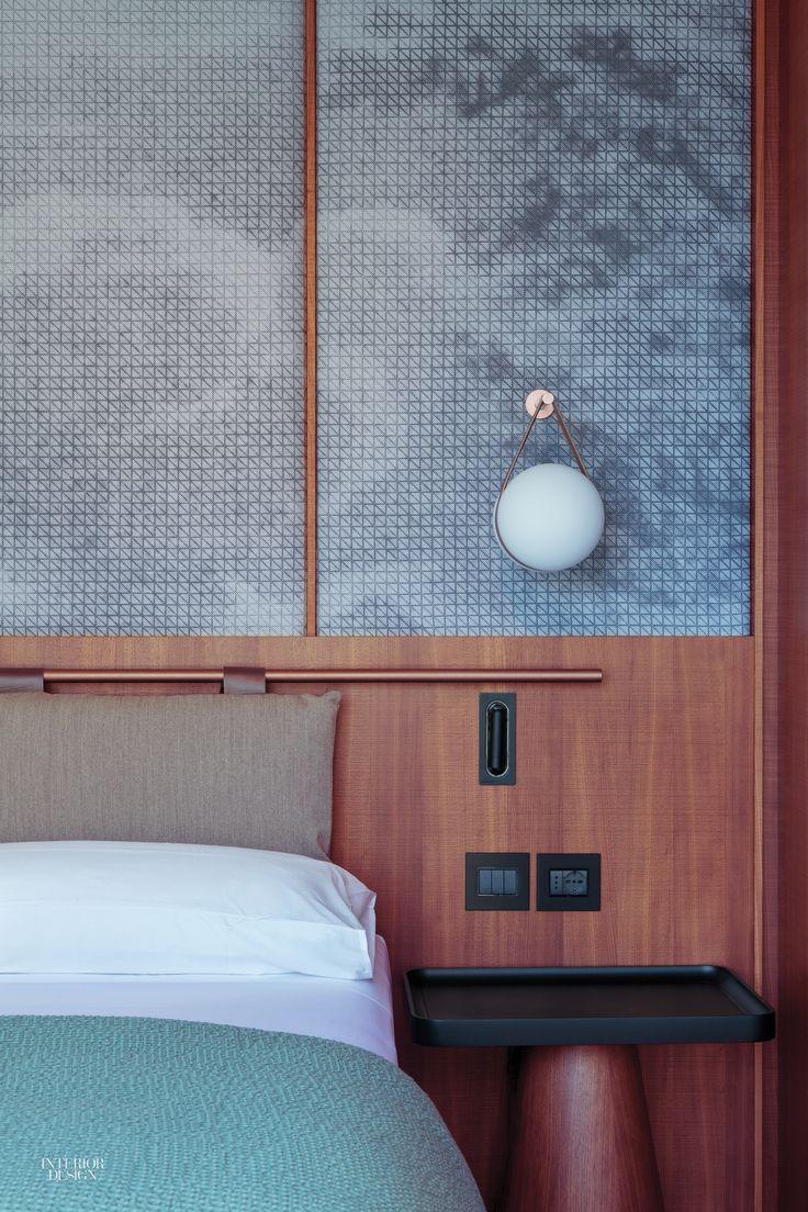 Patricia Urquiola Designs Idyllic Lake Como Hotel Il Sereno Copper pipe headboard and graphic backdrop.