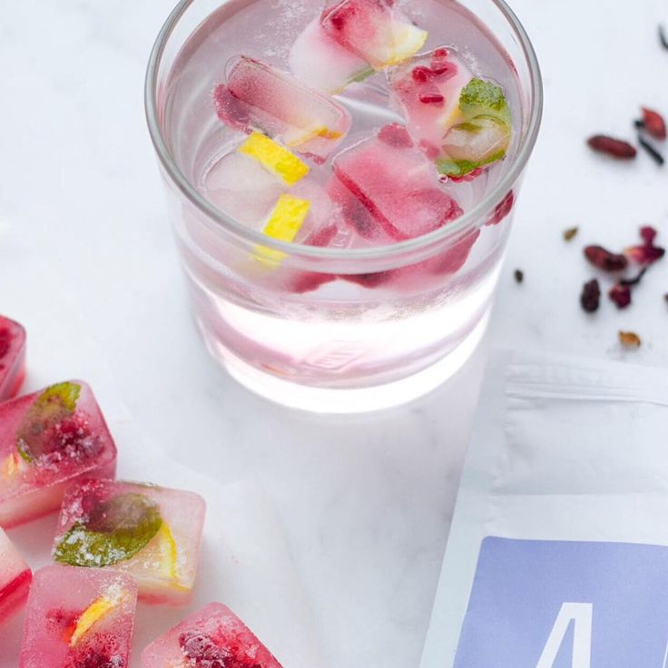 Fruity Ice Cubes // Did you know that we're supposed to have 8 glasses of water a day?  Have fun while staying hydrated & add fruit to your ice blocks next time. Your water will taste delicious   www.skinnymetea.com.au