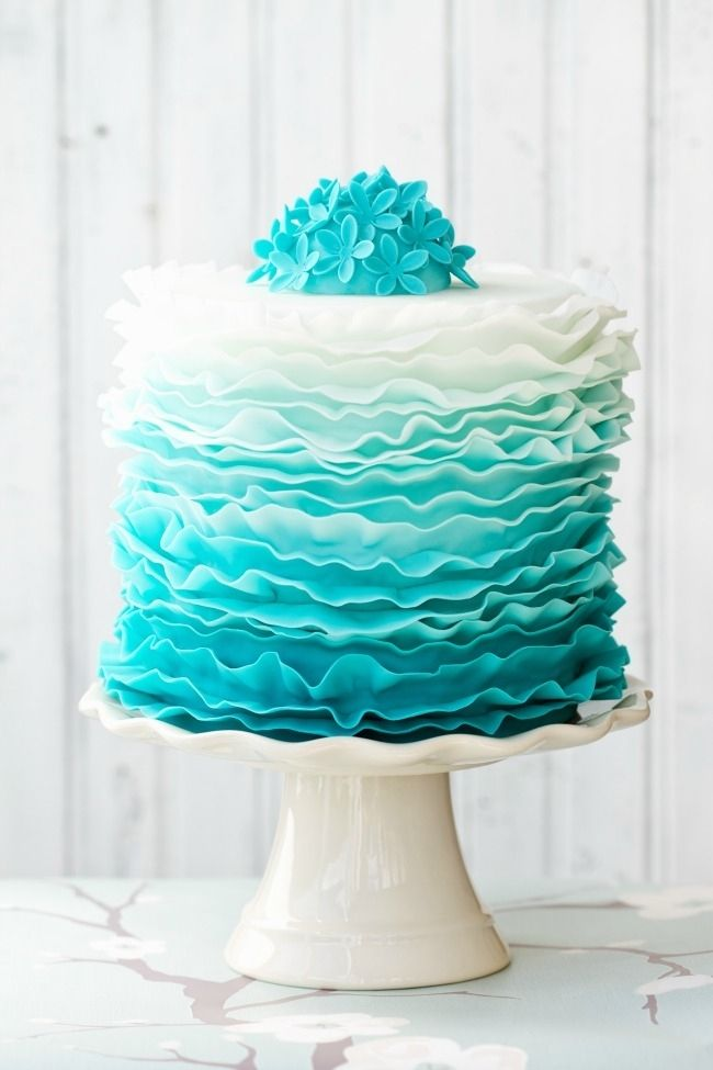 Getting ruffled: This ruffled fondant cake is a stunner: in blues for boys, pinks for little girls! #babyshower #cake #fondant