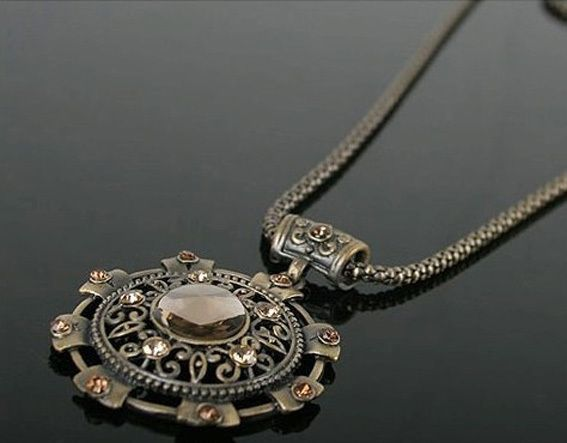 The new Fashion gold-plating years compass alloy pendant vintage sweater necklace! $1.75