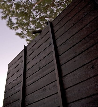 """Shou-Sugi-Ban Wood Siding The sugi was burned to resist rot and fire (it's harder for something already charcoaled to catch fire again). The result is a board that has a dynamic appearance. From different angles it can look black, silver, or dark brown."""""""