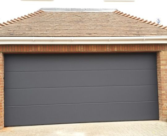Sectional Garage Door in RAL7016 Anthracite Grey. Made out of steel and automated.