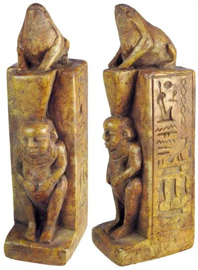 "Brown limestone Bes, the Egyptian dwarf God believed to guard against evil and misfortune, on a four sided base with hieroglyphics. A frog rests at the top. 26th Dynasty 663 - 525 BC 7 1/2"" x 2"" x 3"""