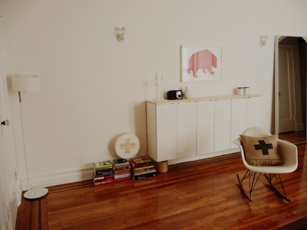 Brilliant solution for an entry table. These are Ikea upper cabinets with a simple pine board on top.