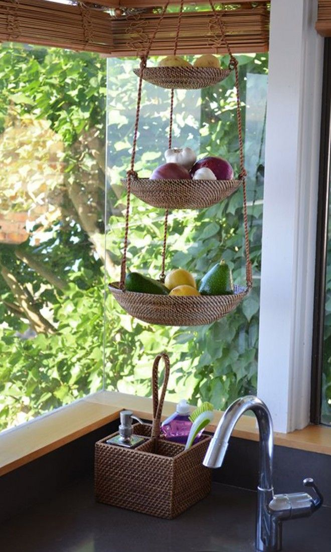 great idea to save space on kitchen countertop - hanging fruit and veggie baskets//