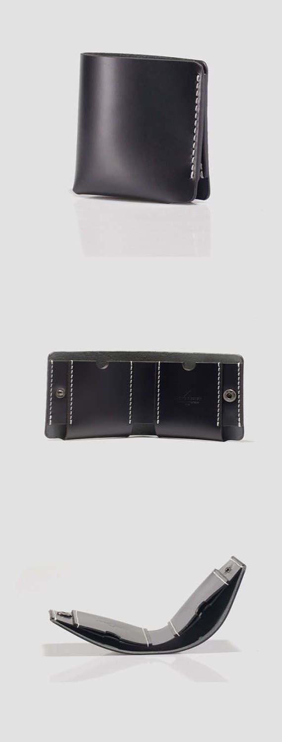 """FREE SHIPPING BLACK FRIDAY + 25% OFFStylish and sleek billfold wallet, tailored in premium leather, opens to reveal inside pockets, compact yet convenient leather wallet. Snap closure Silvertone hardware Two slip pockets One inside bill pocket W 3.35"""" x H 3.74"""" Leather Black A One"""