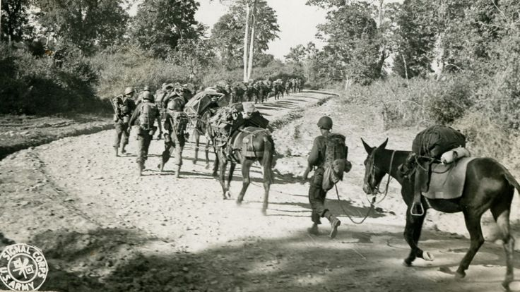 WWII regiment marches through Myitkyina. Photographer Quaid
