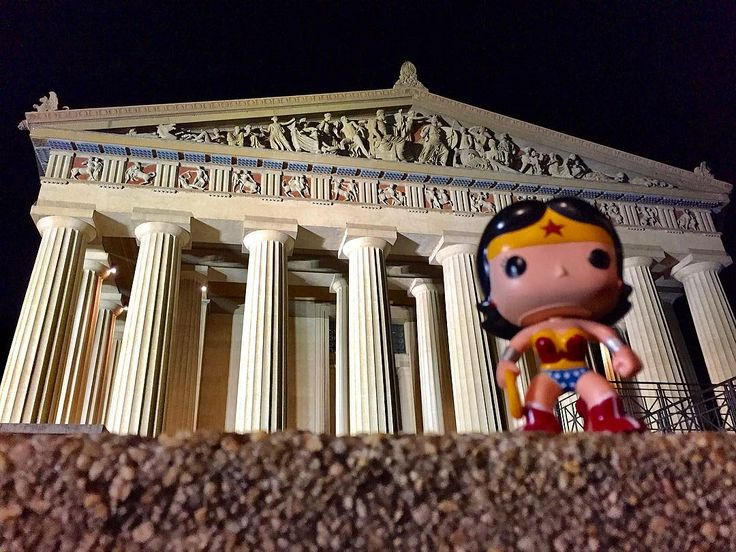 Lil' Wondy visits the (Nashville) Parthenon!  Description: a night shot of a cartoonish Wonder Woman doll in front of a full-sized recreation of the Parthenon in Nashville, Tennessee.