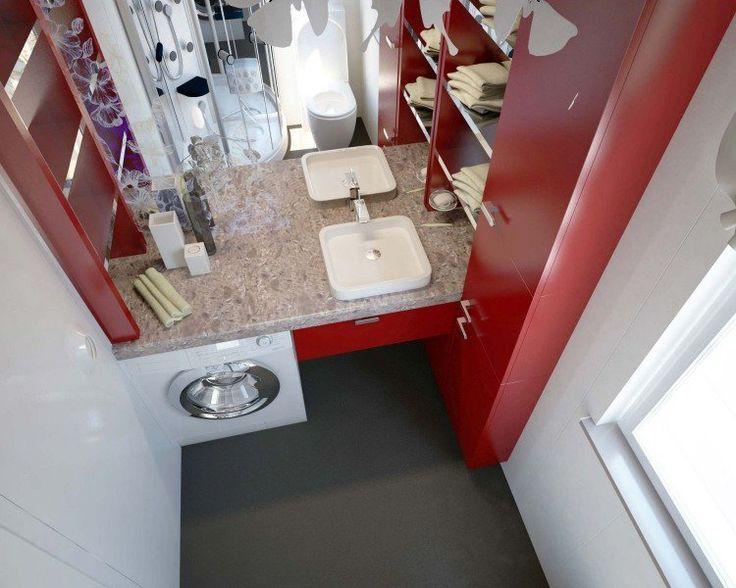 machine à laver dans la salle de bain moderne, meuble de rangement rouge laqué et sol gris anthracite