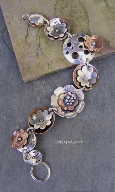 Things like this make me wish I did metal work.  from: Hodgepodgerie Designs.