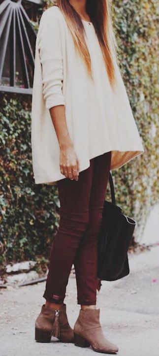 Red Wine Blood Red Skinny pants. Oversized cream blouse, chunky ankle boots. Black hand bag.