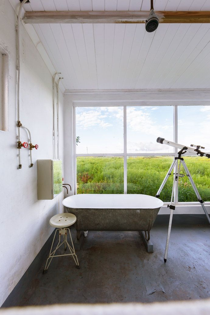 Kobus bought the enamelled tin bath at the eclectic Koöperasie Stories store in Simondium, near Paarl, and the K-Way lunar telescope is from CapeUnion Mart.