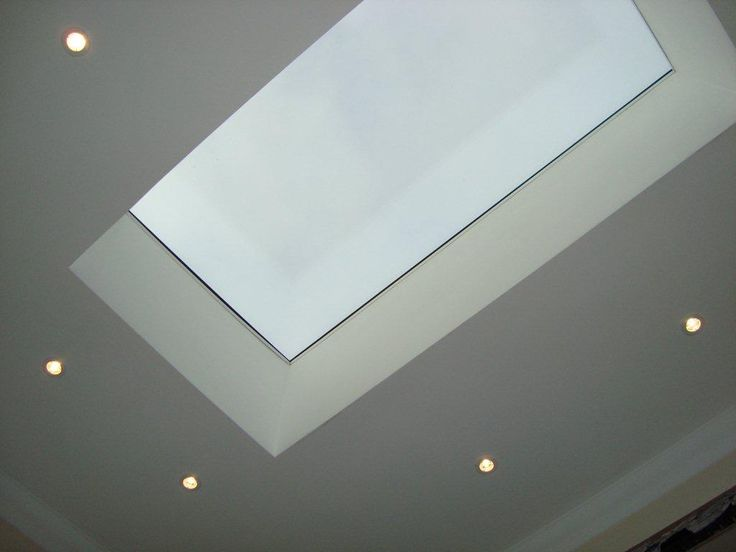 Why not fit a frameless glass skylight to your flat roof extension.  Adding spotlights really make it a feature.....and these are triple glazed giving superb energy performance.