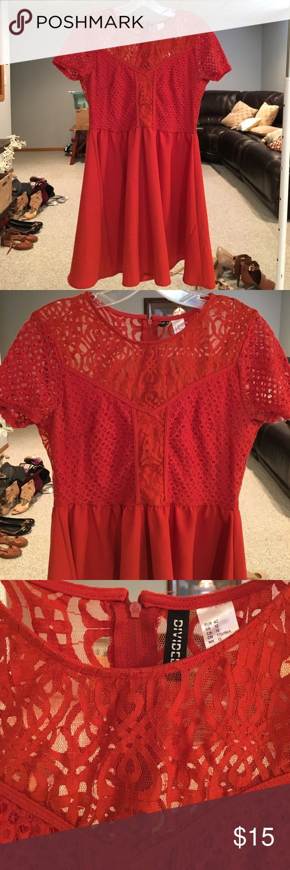 Intricate orange lace dress Lace on top, flown skirt on the bottom. Actually a burnt orange color (lighting causes it to look red). Make me an offer! Runs small: would say it fits size 8-10 Divided Dresses