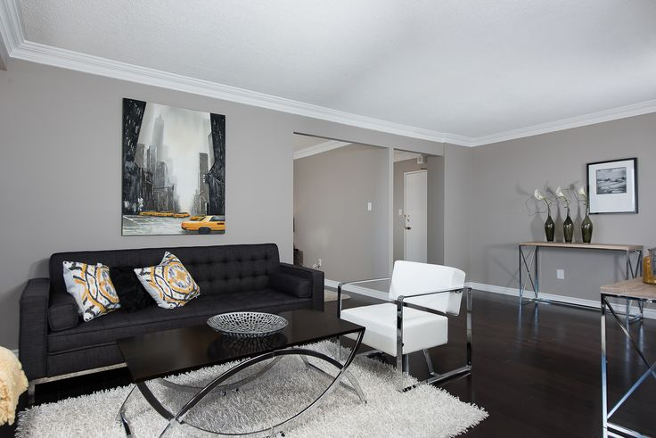 Contemporary condo living in yellow and grey