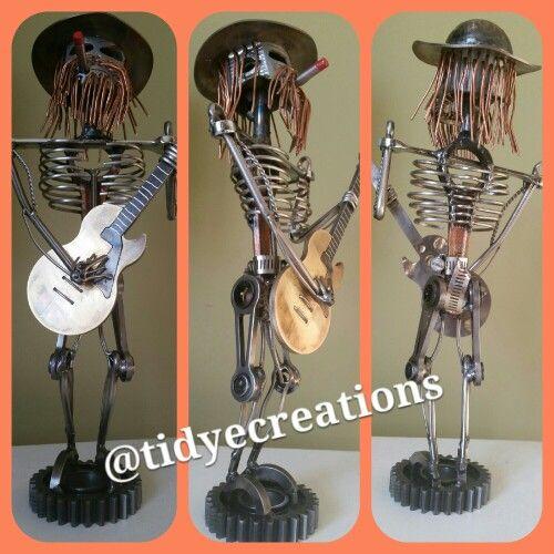 Scrap metal guitar player, guitarist. Metal art welding art. Mig welded reclaimed metal les Paul guitar