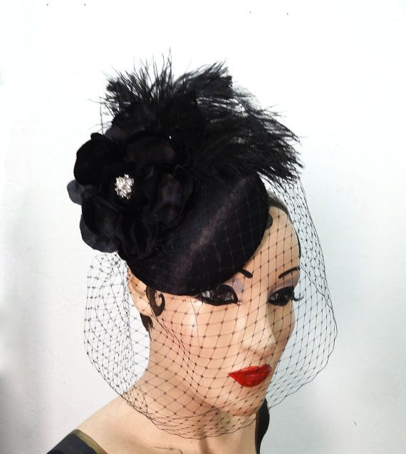 Hey, I found this really awesome Etsy listing at http://www.etsy.com/listing/120140308/cocktail-hat-black-satin-feather