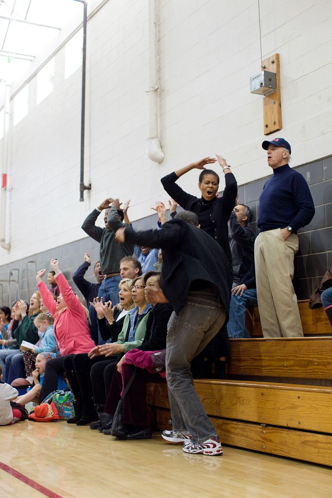 President Barack Obama, First Lady Michelle Obama, Vice President Joe Biden, and Dr. Jill Biden, react while watching Sasha Obama and Maisy Biden, the Vice President's granddaughter, play in a basketball game in Chevy Chase, Md., Feb. 27, 2010.  (Offic...