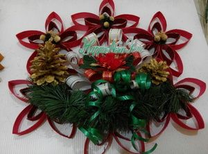 Upcycled handmade wreath is By Niek's Burlap & Lace. Also available in green.